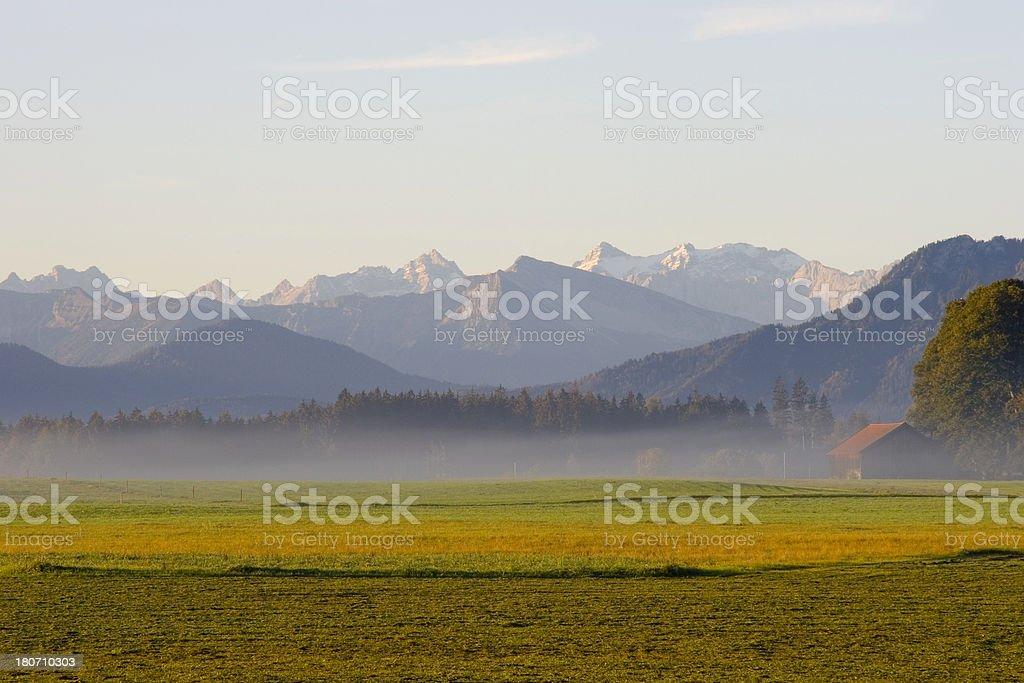 foggy sunrise with mountains royalty-free stock photo