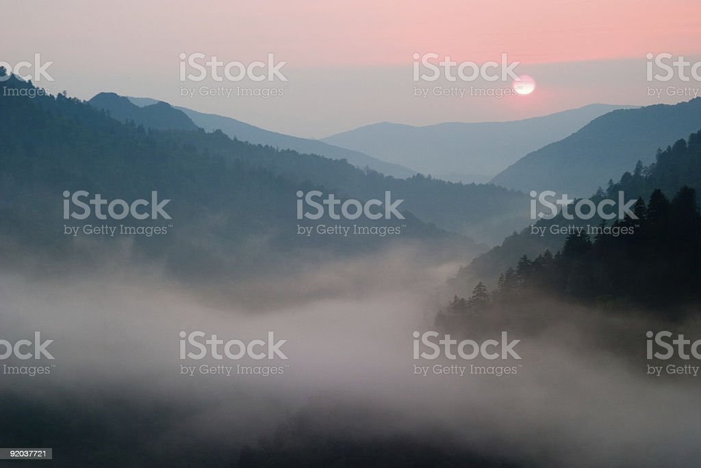 Foggy sunset at Morton Overlook in the Smokey Mountains stock photo
