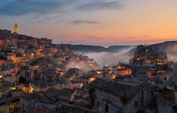 Foggy sunset at Sassi di Matera stock photo