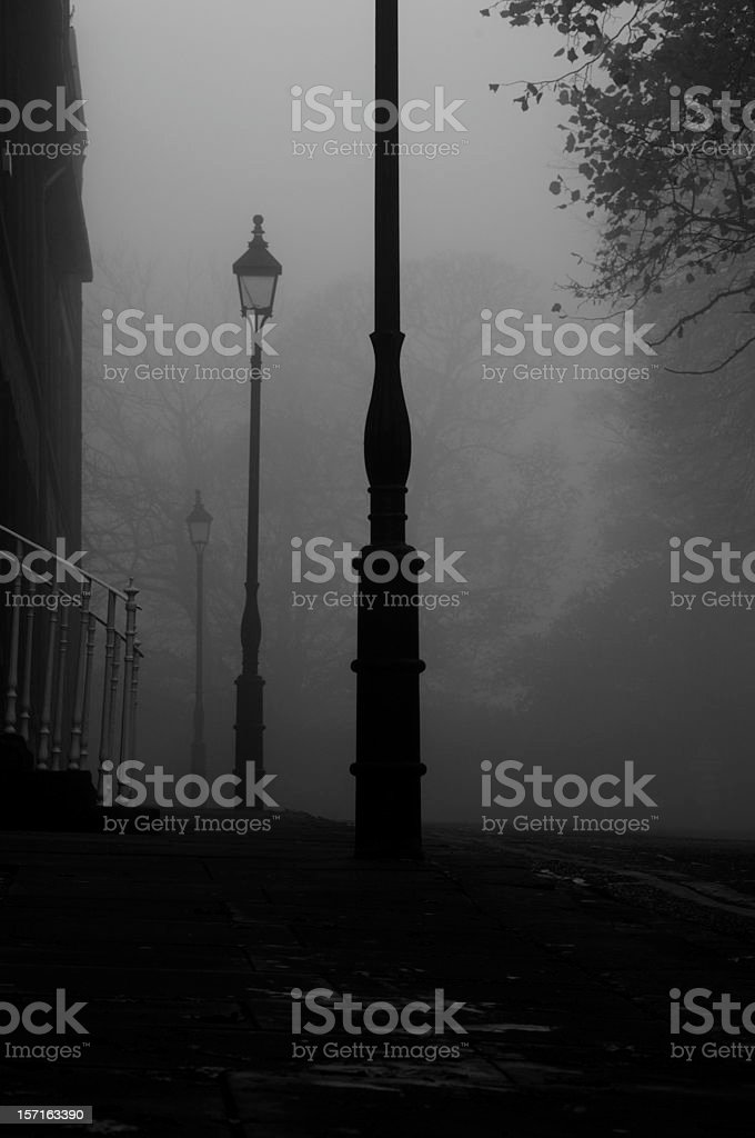foggy victorian street early evening royalty-free stock photo