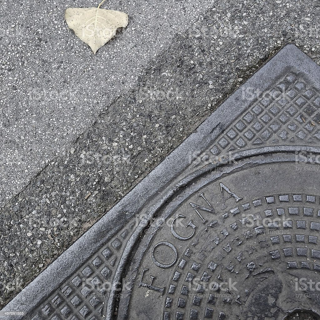 Fogna - Sewer manhole in Italian royalty-free stock photo