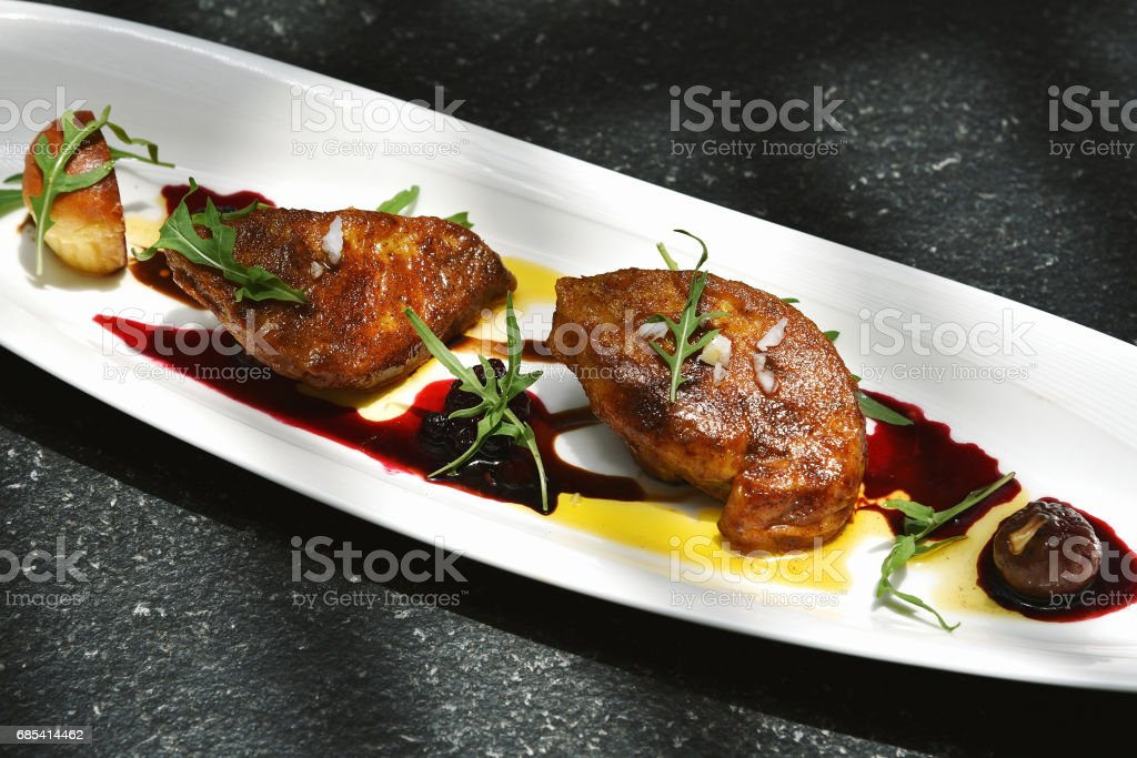 Foie gras grilled served with red berries sauce and chestnut. foto de stock royalty-free