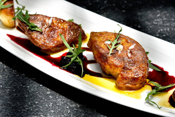 Foie gras grilled served with red berries sauce and chestnut. – Foto