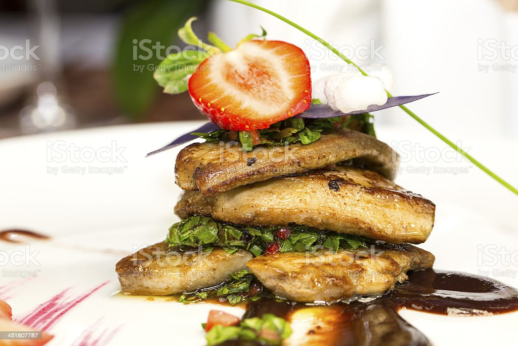 foie gras with strawberries and berry sauce royalty-free stock photo