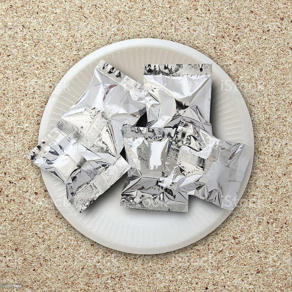 foil package on white plate royalty-free stock photo