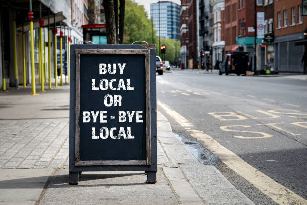 BUY LOCAL OR BYE - BYE LOCAL. Foldable advertising poster stock photo