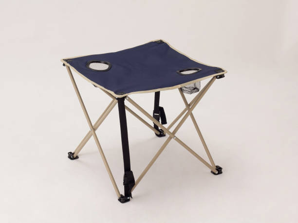 foldable camping canvas table isolated on white stock photo