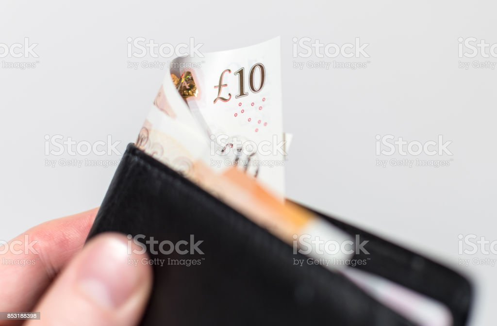 Folded £10 note - UK Currency in a wallet stock photo