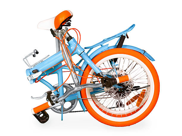 Folded bike Blue folded bike isolated on white with full clipping path foldable stock pictures, royalty-free photos & images
