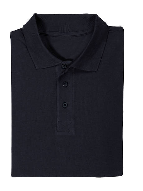Folded black polo shirt isolated on white stock photo