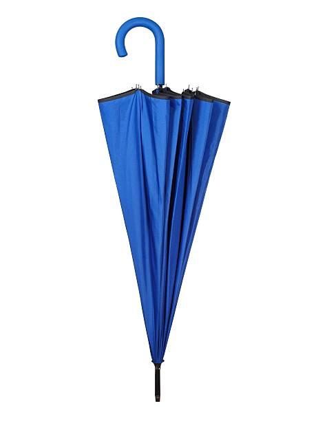 Folded blue umbrella on white stock photo
