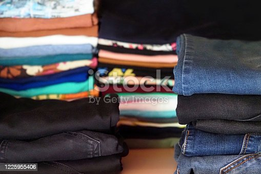 1146468307 istock photo Folded clothes in the closet, t-shirts and jeans 1225955406