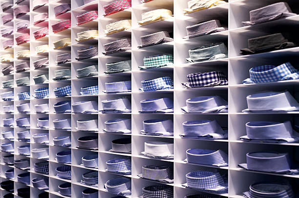 folded colourful shirts - mens fashion stock photos and pictures