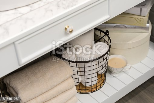 618327092istockphoto folded cotton towel under white marble bathroom marble counter 627461262