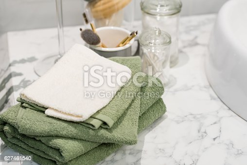 618327092istockphoto folded cotton towel under white marble bathroom marble counter 627461540