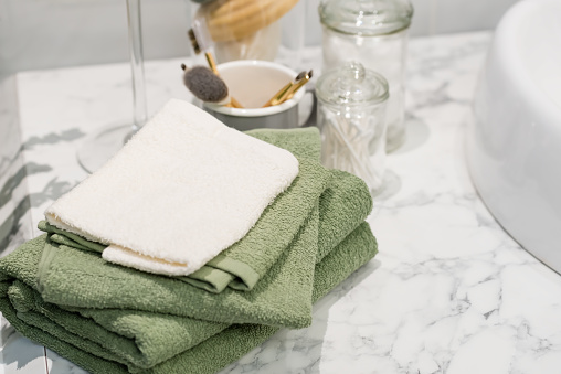 618327092 istock photo folded cotton towel under white marble bathroom marble counter 627461540