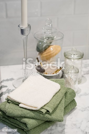 618327092istockphoto folded cotton towel under white marble bathroom marble counter 628565106