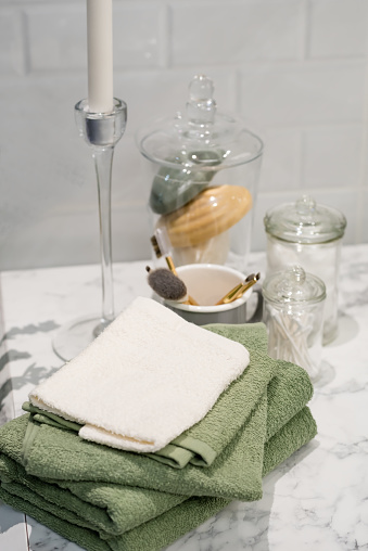 618327092 istock photo folded cotton towel under white marble bathroom marble counter 628565106