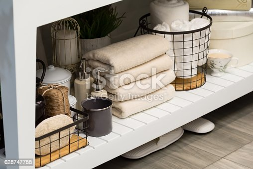 618327092istockphoto folded cotton towel under white marble bathroom marble counter 628747788