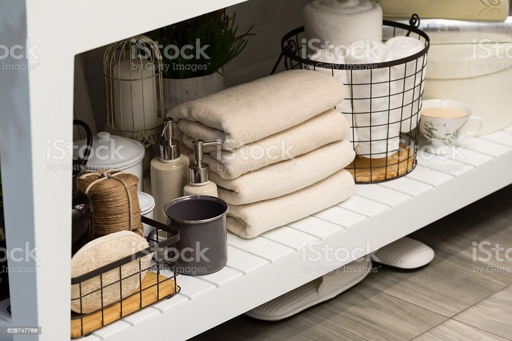 folded cotton towel under white marble bathroom marble counter stock photo