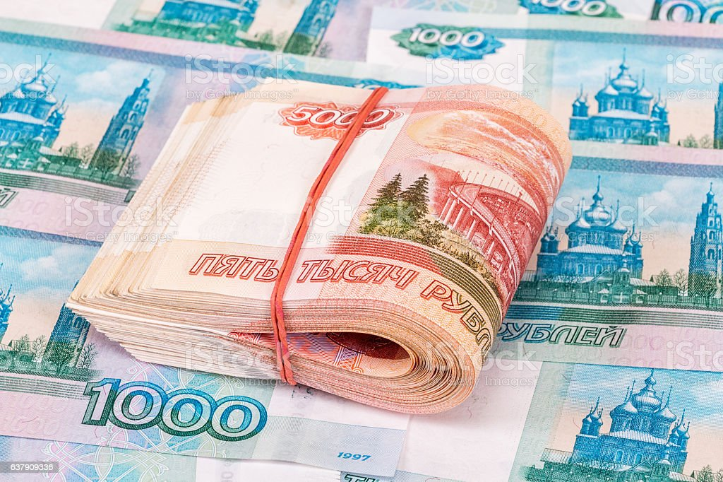 Folded five thousandths banknotes of russian roubles on money stock photo