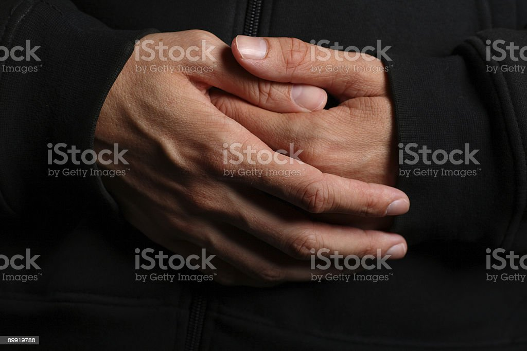 Folded hands of a priest stock photo