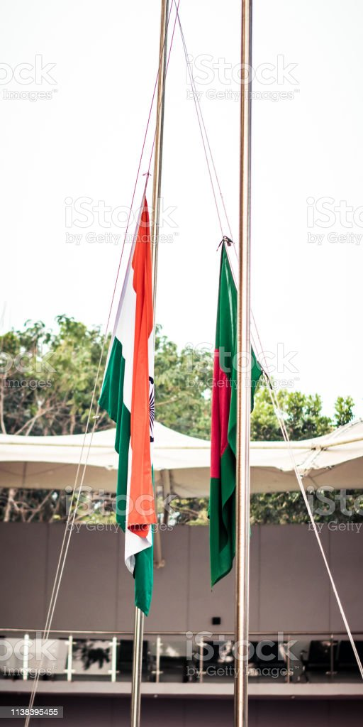 Folded India and Bangladesh national flag waving in the wind together. Diplomacy concept, international relations. stock photo