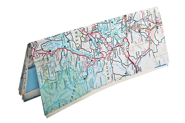 folded map standing - road map stock photos and pictures