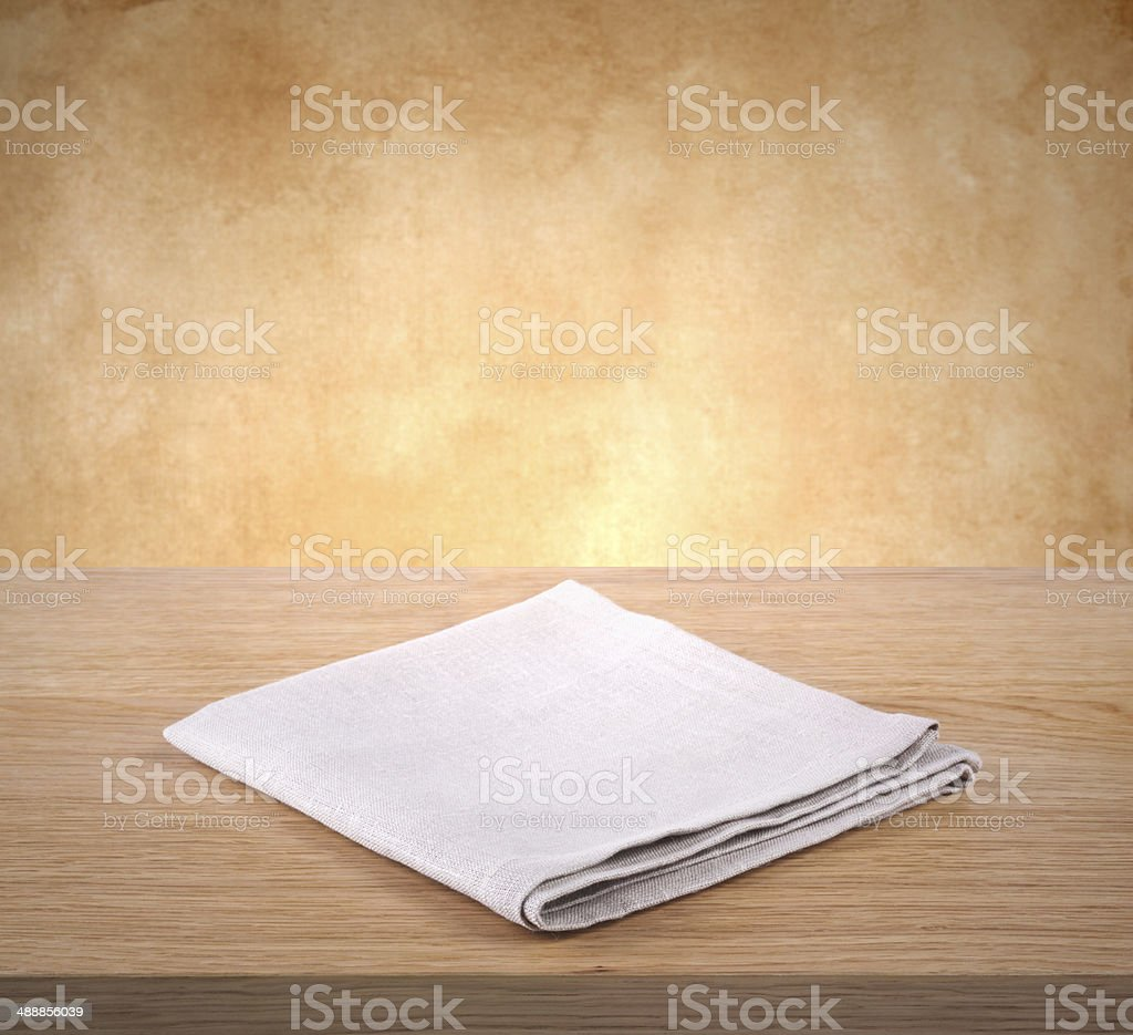 Folded napkin on wooden table stock photo