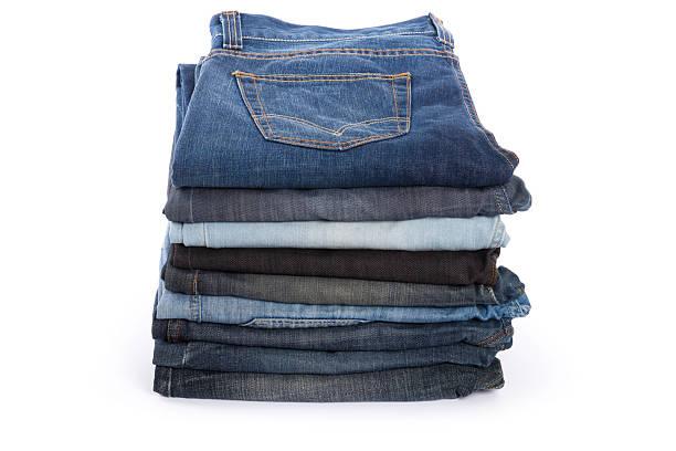folded old jeans - zwarte spijkerbroek stockfoto's en -beelden