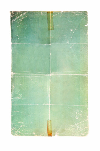 Folded green poster with decay tape pieces.