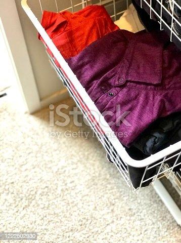 1164403364 istock photo Folded purple shirt in wardrobe drawer 1222502930