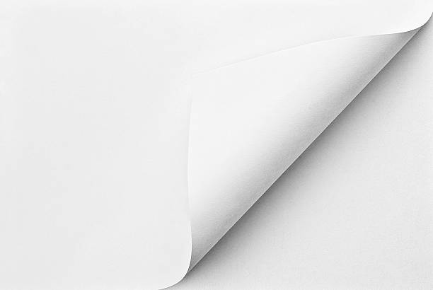 folded sheet of paper with curled corner - curled up stock pictures, royalty-free photos & images
