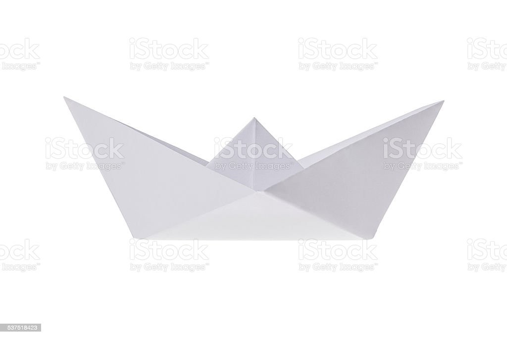 Folded ship, made out of paper on a white background. stock photo