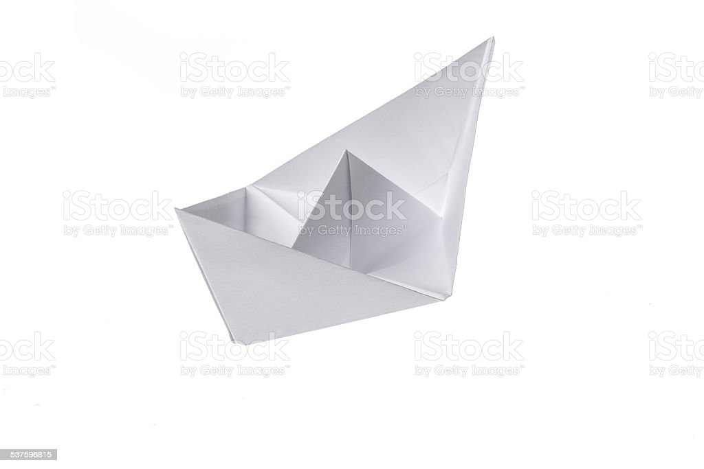 Folded ship, made out of paper on a white background stock photo