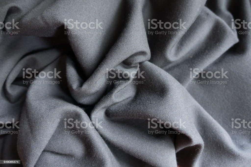 Folded simple unprinted dark grey viscose fabric stock photo