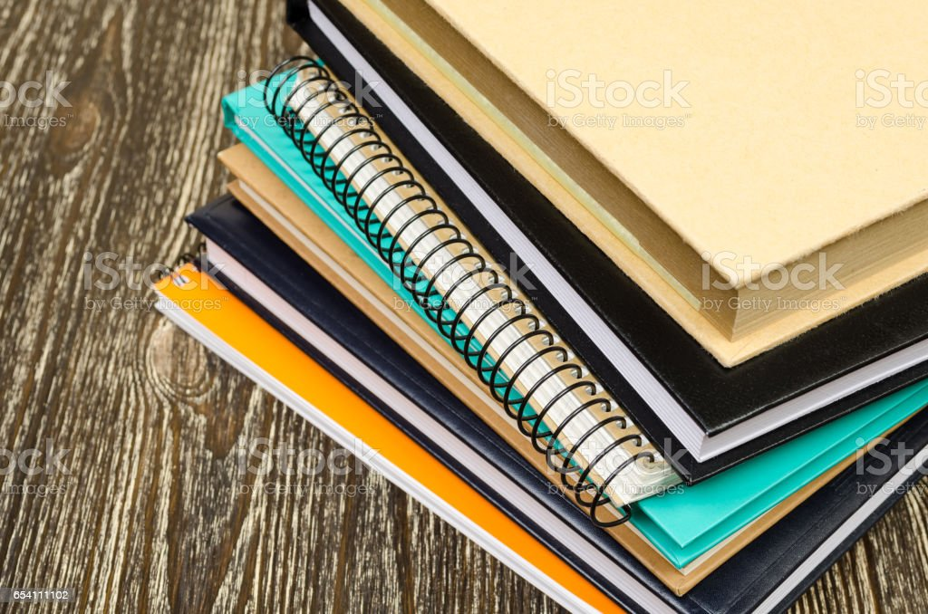 folded stack of workbooks. - foto de acervo