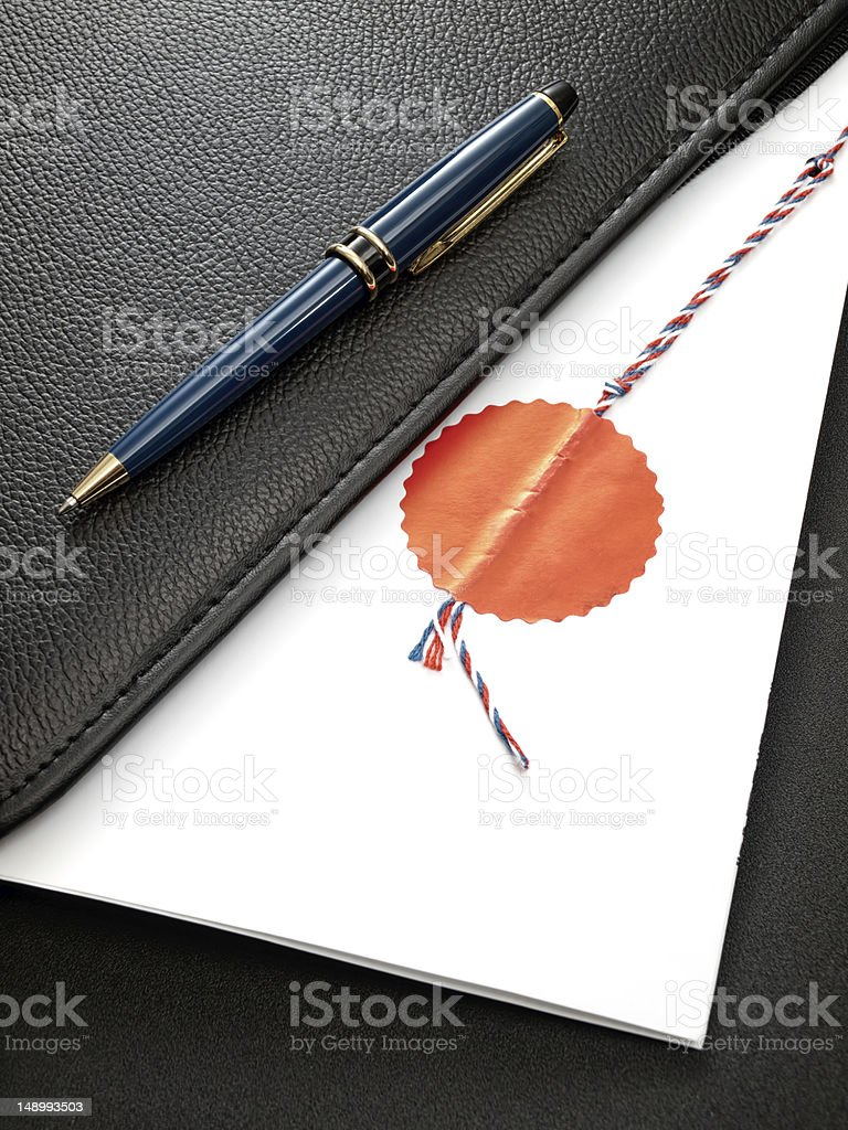 Folded stamped contract with pen  royalty-free stock photo