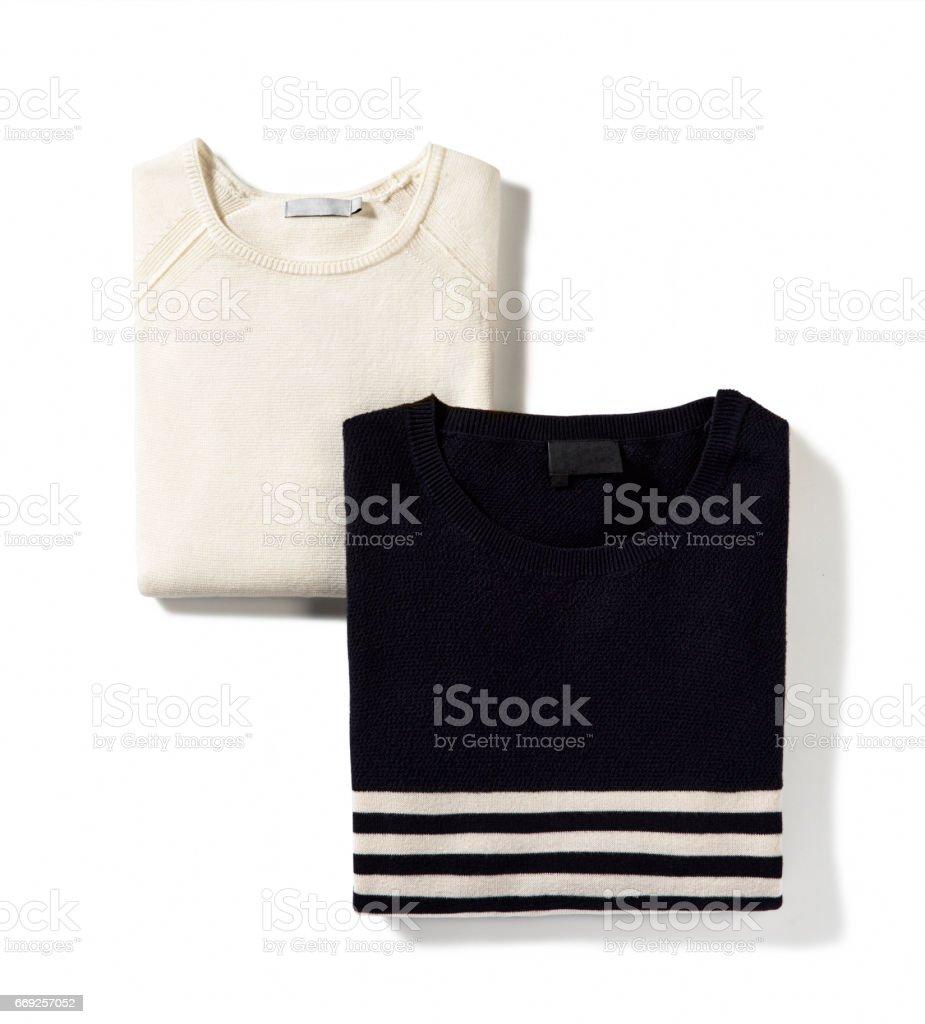 Folded sweaters isolated on white background stock photo