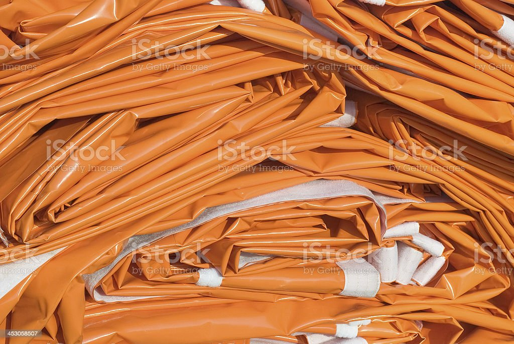 Folded Tarpaulin in Orange stock photo