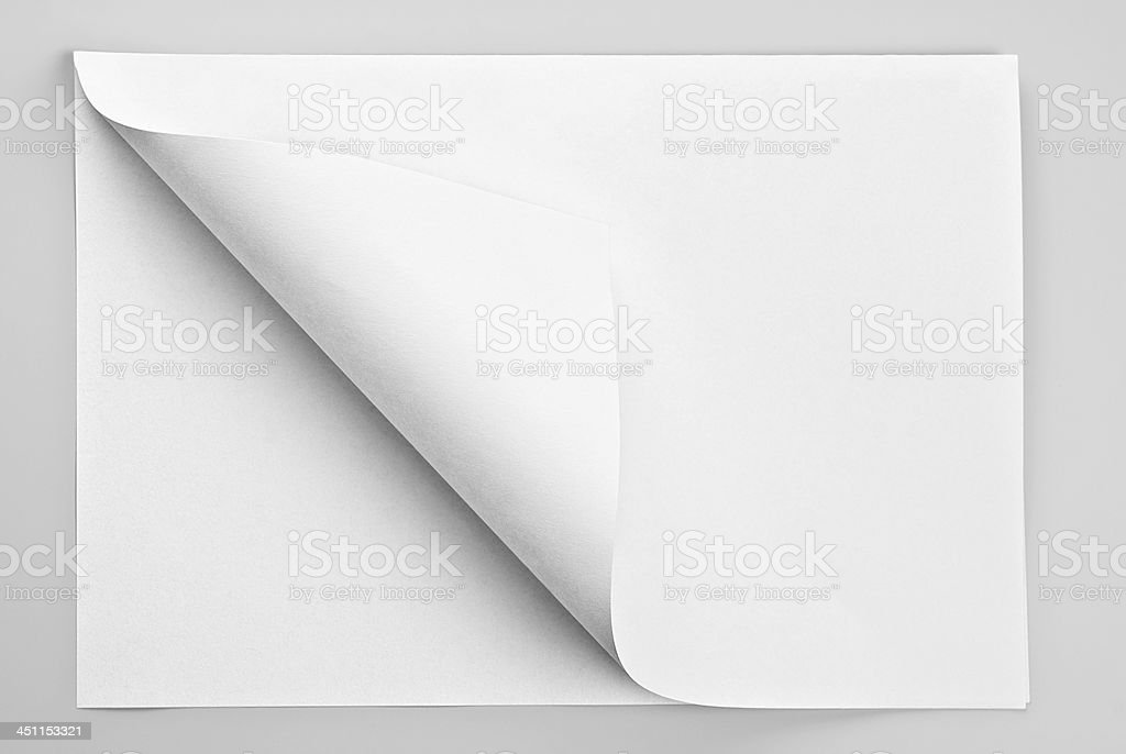 Folded white sheet of paper with curl corner stock photo