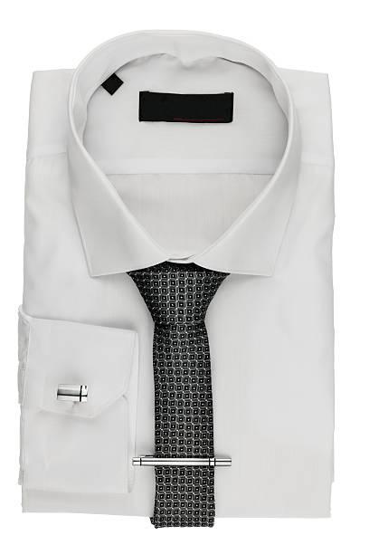 folded white shirt with a tie and cufflinks - krawattennadel stock-fotos und bilder