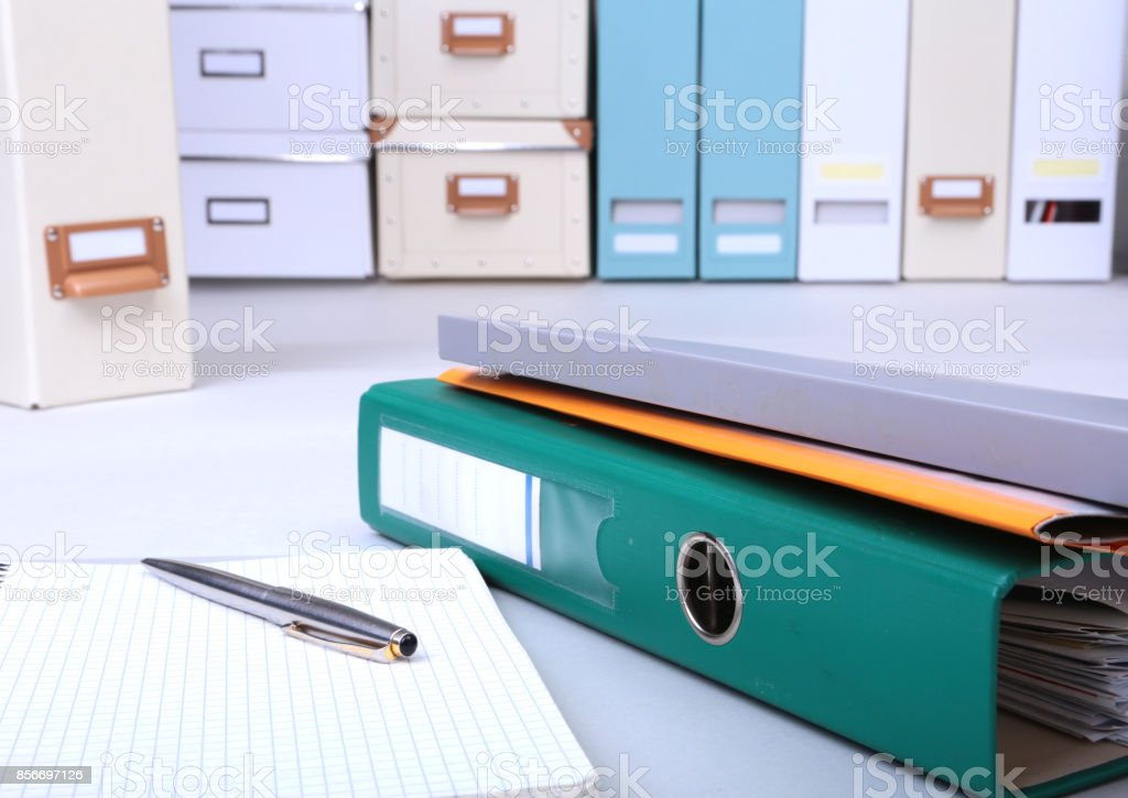 Folder file, note and pen on the desk. blurred background. stock photo