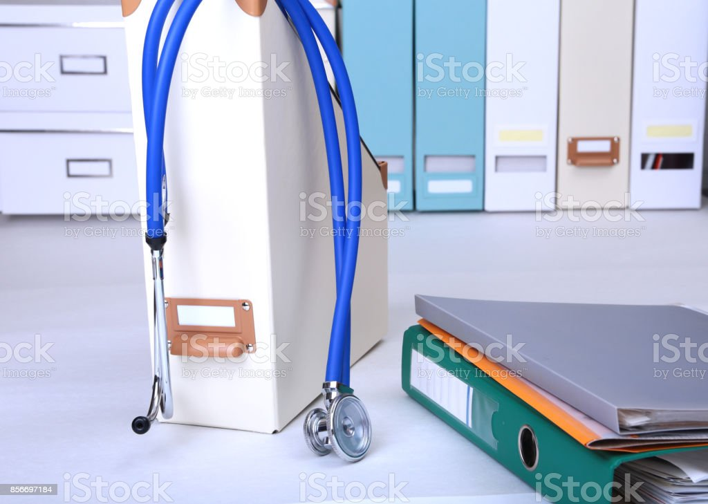 Folder file, stethoscope and RX prescription on the desk. blurred background. stock photo