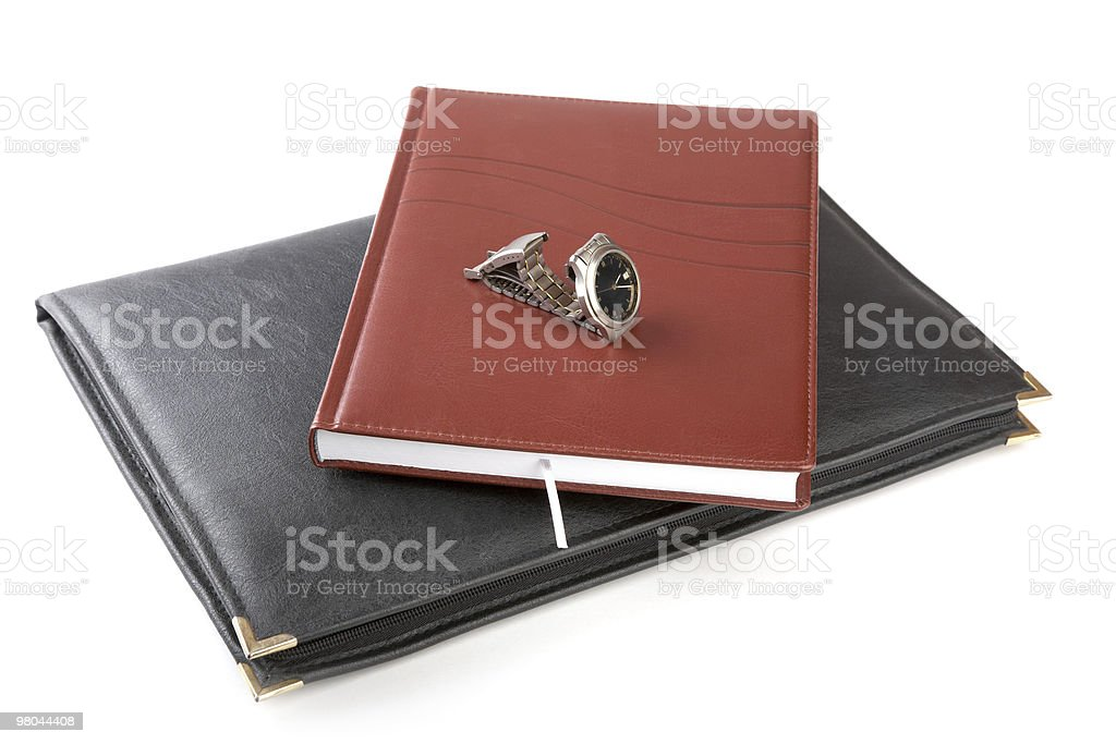 Folder for papers, organizer and watch royalty-free stock photo