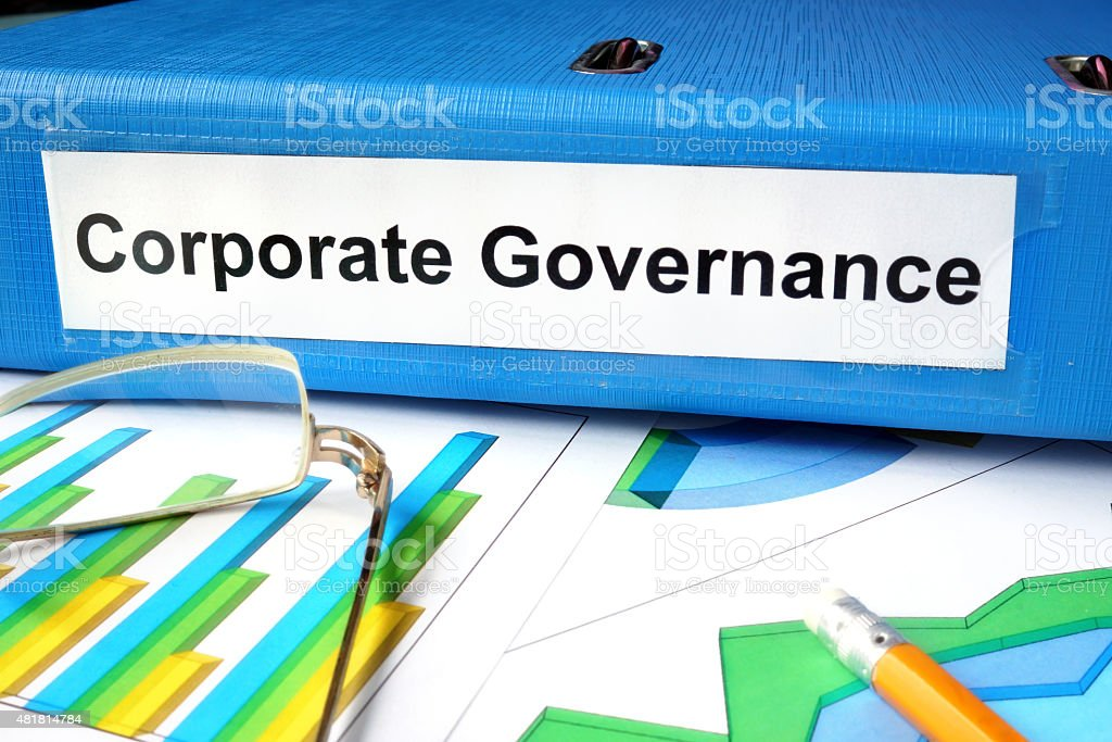 Folder with label Corporate Governance  and charts. stock photo