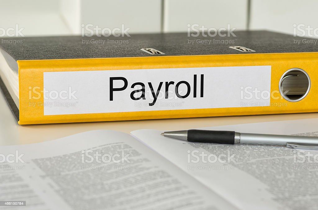 Folder with the label Payroll stock photo
