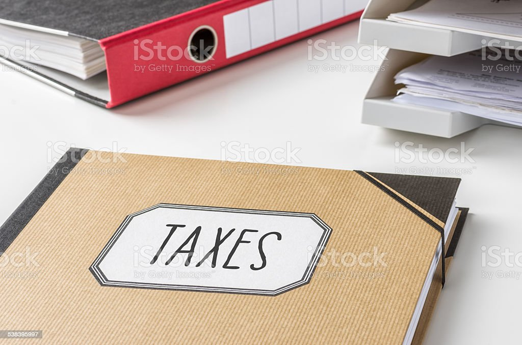 Folder with the label Taxes stock photo