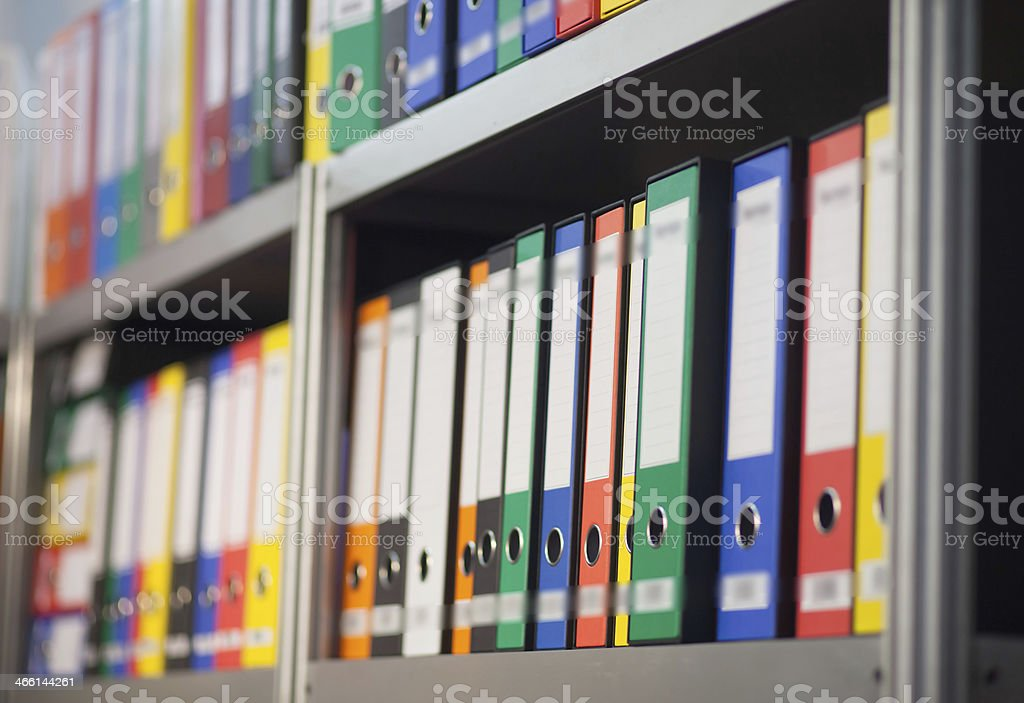 folders on bookshelf stock photo