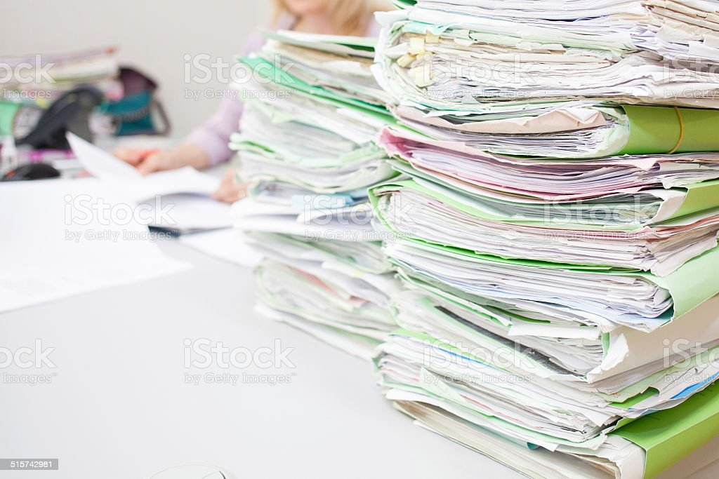 folders on desk stock photo